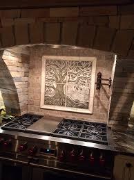 handmade sgraffito carved ceramic backsplash tile the nest