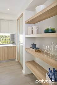 beautiful mid block contemporary house in australia with black and shelving base and pantry doors in ravine natural oak overhead doors in melamine classic