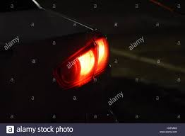 discounted rear car lights in the stop signals stock photo
