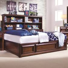 brown day bed with storage drawers underneath and rack