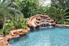 rock waterfalls for pools pools with slides and waterfalls pool with weeping rock waterfall