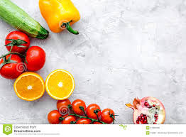 diet food with fresh fruits and vegetables salad stone background