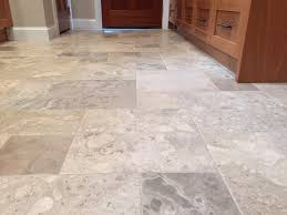 kitchen and dining room flooring with travertine tile floor touchdown tile llc a minnesota contractor this kitchen dining room foyer and mudroom were all tiled