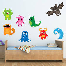 happy monsters wall stickers by mirrorin notonthehighstreet com happy monsters wall stickers