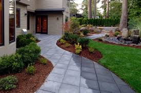 outdoor backyard with garden then checkered floor and the house