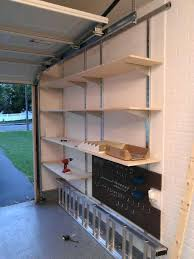 car garage organization ideas with diy wall mounted pegboard and