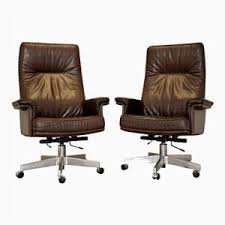 Leather Swivel Armchairs Discover Vintage Swivel Chairs Online At Pamono