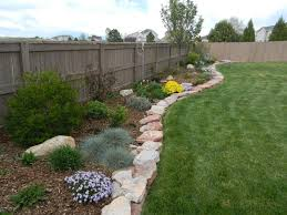 zeroscaping to xeriscaping in colorado along fence great diy