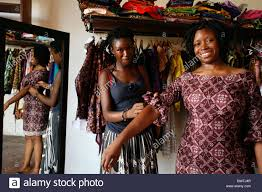 fashion designer and her customer in a dress fitting in a boutique