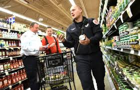 countryside firefighters shop for thanksgiving dinner for needy families