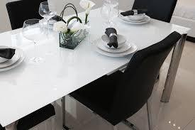 sleek and spacious cameron glass extendable dining table