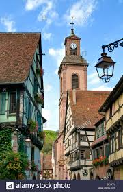 church and street scene in french town of trelly in normandy