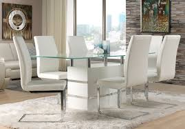 cute glass dining table with white chairs
