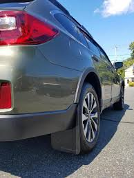 rally subaru outback rally armor mud flaps on top of wheel arch moldings subaru
