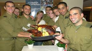 lone soldiers dig in to thanksgiving dinner in tel aviv the