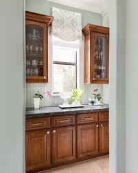how to make cabinets appear taller those pesky kitchen windows and how to make them look