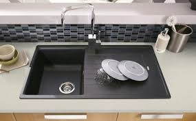 beautiful black composite kitchen sink on small kitchen room with