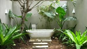incredible outdoor bathroom ideas with neutral green plant and incredible outdoor bathroom ideas with neutral green plant and oval shape white bathtub