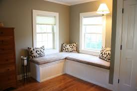 gray velvet seat cushion pad over l shaped white beadboard window