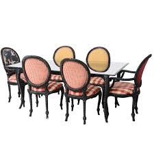 set of eight dining chairs and table hollywood regency style