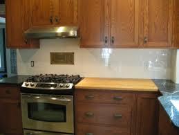 New Caledonia Granite Countertops And White Glass Tile Backsplash - White glass backsplash tile
