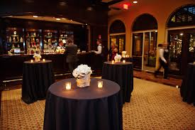 restaurant high top tables black tablecloths on the high top tables in the cocktail area