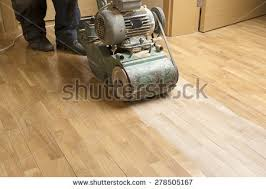 wood floor polishing maintenance work by stock photo 278505167