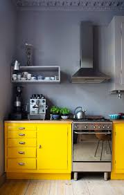 kitchen with yellow walls and gray cabinets love the bo of the yellow cabinets and gray walls doing a