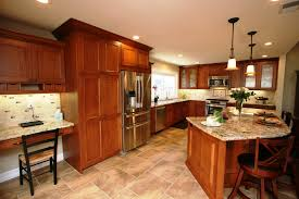 quartz countertops natural cherry kitchen cabinets lighting