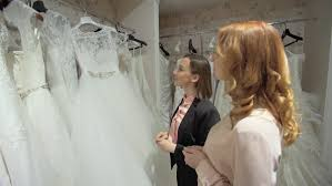 bridal consultant two women discussing the and the bridal consultant