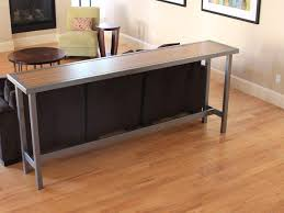 simple home decoration with behind the couch steel table and