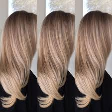 well blended creamy toffee blonde balayage for long hair