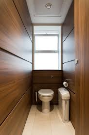 Ironwood Manufacturing Wood Veneer Restroom Partition Alto Full Height Flush Fascia Cubicles Faced With Walnut Effect