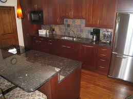 Kitchen Colors With Oak Cabinets And Black Countertops by Dark Brown Wooden Kitchen Cabinets And Island Having Black Marble