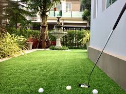can i install artificial grass on top of real grass install it