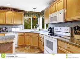 White Kitchen Cabinets White Appliances bright kitchen room interior with white appliances stock photo