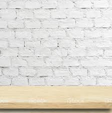 Wooden Table Empty Wooden Table Over White Brick Wall Template Stock Photo