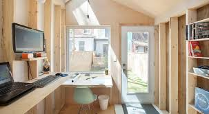 architect builds a tiny studio in his backyard to be closer to his