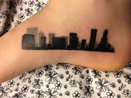 ink for a giant city skyline tattoo on foot