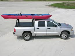 nissan frontier kayak rack access rollup truck bed cover and rack combination