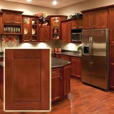 cherry cabinets kitchen colors backsplash white counter with black