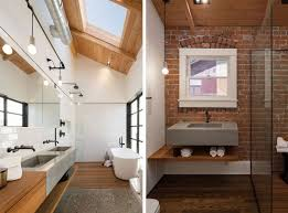 bathroom with exposed brick wall