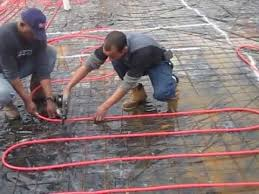 installing pex tubing for infloor radiant heating with a pex gun