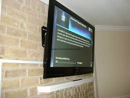 tv on brick fireplace installation houston custom installers