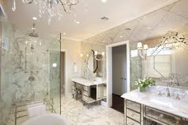 bathroom with antique mirror tiles and crystal chandelier