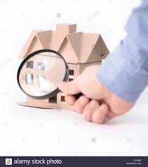 house architectural model under magnifying glass stock photo