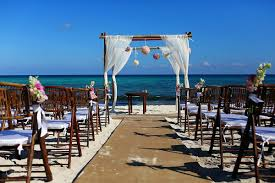 pretty ceremony set up on the beach at le reve boutique hotel in