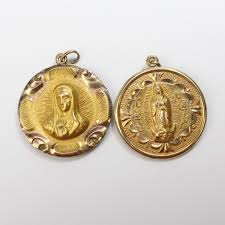 religious pendants gold filled 25 7g pair of religious pendants property room