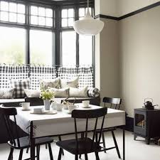 minimalist dining area with corner sofa black bench and black
