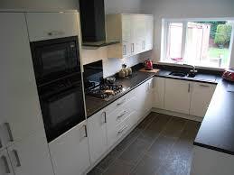 kitchen appliance kitchen counter ceiling lights cherry cabinets